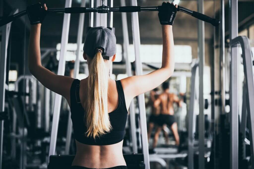 A sexy woman exercising in the sport gym