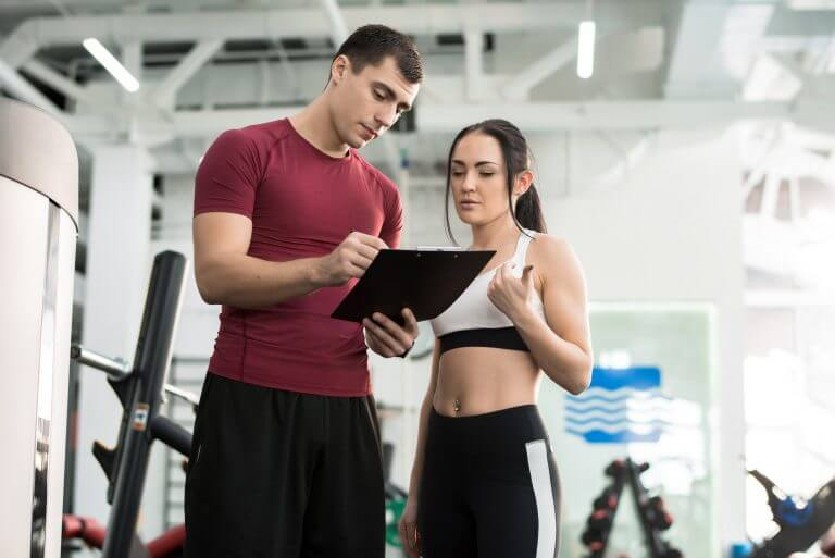 Woman Talking to Fitness Coach